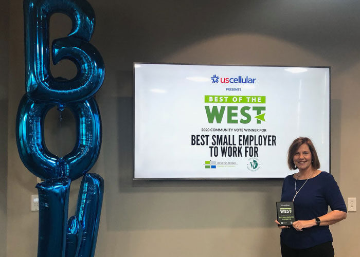 Mary Thomsen pictured with Best of the West Award